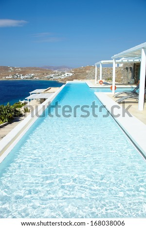Swimming Pool in front of an island home  - stock photo