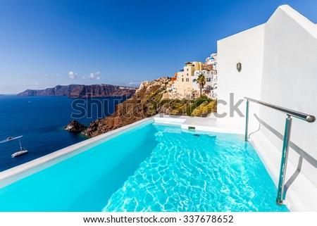 Swimming pool in luxury hotel. Santorini island, Greece - stock photo