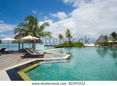 swimming pool in maldives island resort - stock photo