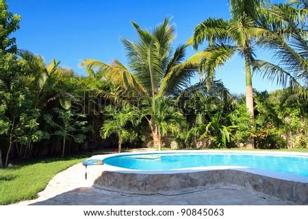 Swimming pool in private villa - stock photo