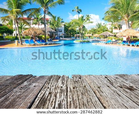 Swimming pool in the tropical hotel - stock photo