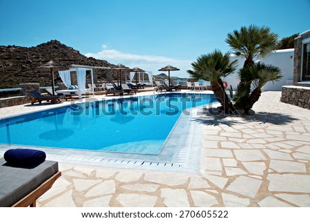 swimming pool of a hotel on a island the summer - stock photo