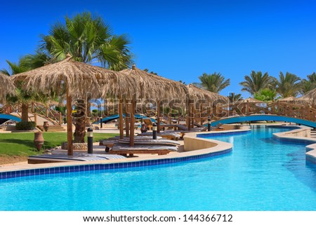 Swimming pool of luxury hotel - stock photo