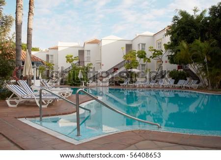 Swimming pool of luxury hotel in Playa de las Americas resort. Tenerife, Canary Islands, Spain. - stock photo