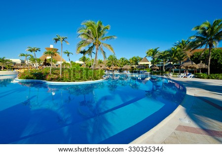 Swimming pool of luxury tropical caribbean resort, hotel.