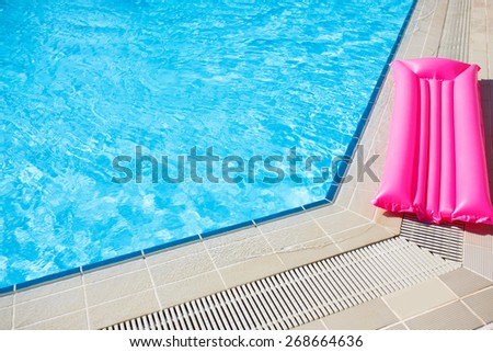 Swimming pool outdoor close up with mattress - stock photo