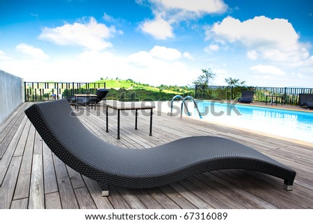 Swimming pool overlooking the mountains and sky - stock photo