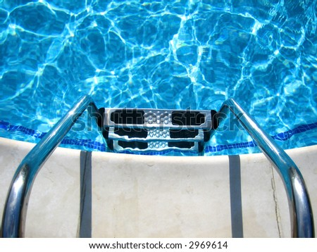 Swimming pool steps - stock photo
