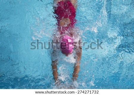 Swimming pool, swimmer at the finish - stock photo