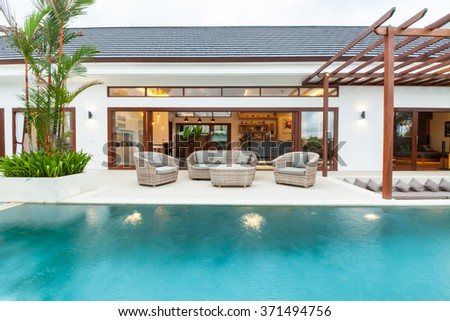 Swimming pool view to living room - stock photo