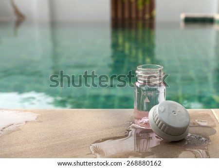 Swimming pool water chlorine testing  - stock photo