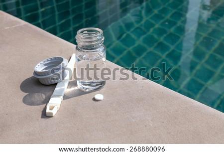Swimming pool water testing equipment - stock photo