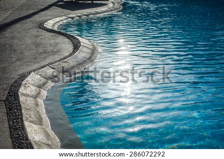 Swimming pool with at hotel close up. - stock photo