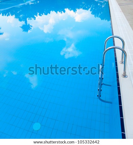 Swimming pool with cloud's reflections - stock photo