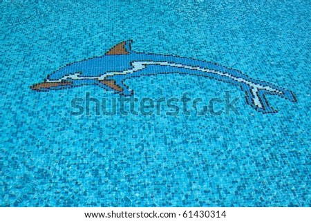 Swimming pool with dolphin - stock photo