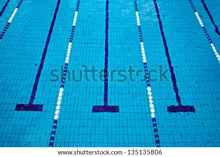Swimming pool with empty lanes - stock photo
