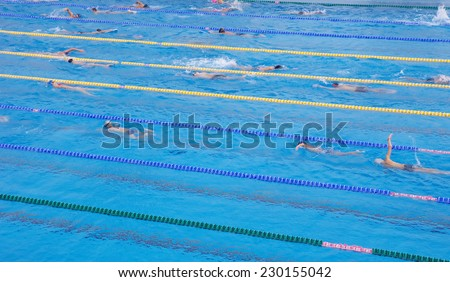 Swimming pool with  exercising children in sunny day  - stock photo