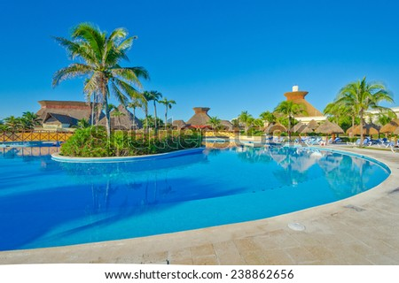 Swimming pool with island at the luxury caribbean, mexican resort.