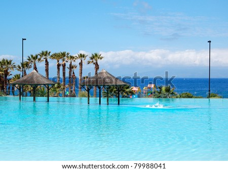Swimming pool with jacuzzi and beach of luxury hotel, Tenerife island, Spain - stock photo