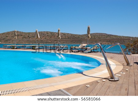 Swimming pool with jacuzzi at luxury hotel, Crete, Greece - stock photo
