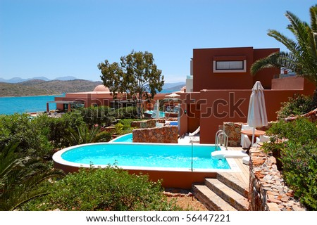 Swimming pool with jacuzzi by luxury villa, Crete, Greece - stock photo