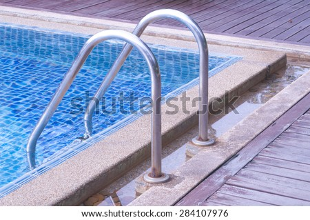Swimming pool with railing stairs down