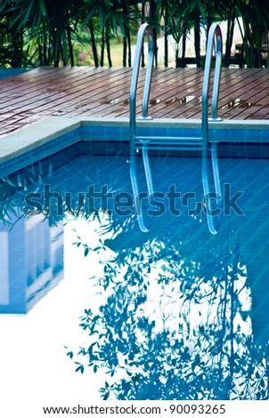 Swimming pool with reflected on water surface