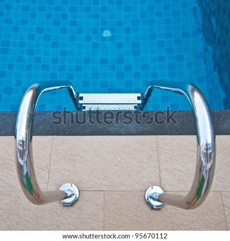 Swimming pool with stair at hotel - stock photo