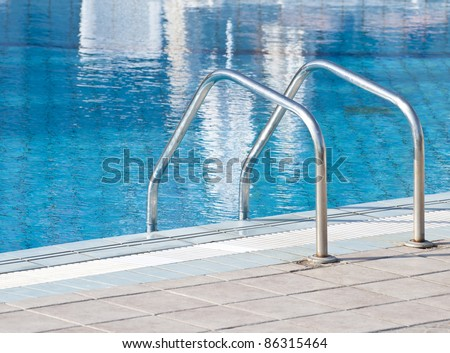 Swimming pool with stairs close up - stock photo