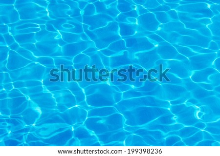 Swimming pool with sunny reflections. - stock photo