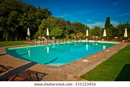 Swimming pool with trees - stock photo