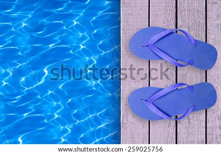Swimming pool, wooden deck and blue beach shoes - stock photo
