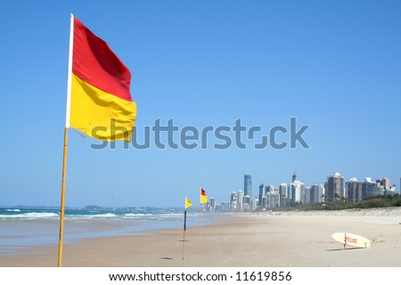 Swimming safety flags on the Gold Coast Northern beach looking towards Surfers Paradise. - stock photo