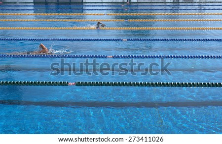 swimming training in swimming pool - stock photo