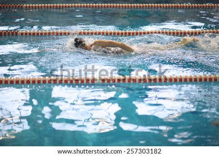 Swimming training in the pool - stock photo