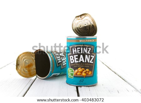 SWINDON, UK - April 10, 2016: Heinz Baked Beanz On a White Wooden Background - stock photo