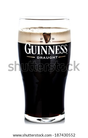 SWINDON, UK - APRIL 15, 2014: Pint of Guinness, the popular Irish beer on a white background - stock photo
