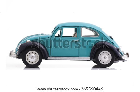 SWINDON, UK - APRIL 1, 2015:  VW Beetle in Blue Die cast model on a white background.