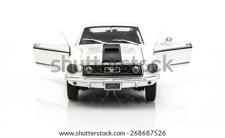 SWINDON, UK - APRIL 12, 2015: White Ford Mustang GT Fastback on a White Background - stock photo