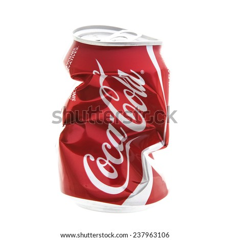SWINDON, UK - DECEMBER 16, 2014: An Empty Dented and Crushed Can of Coca-Cola on a white background  - stock photo
