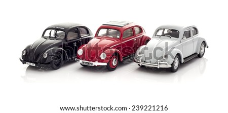 SWINDON, UK - DECEMBER 22, 2014:  Three Vintage VW Beetles  Die cast models on a white background. - stock photo