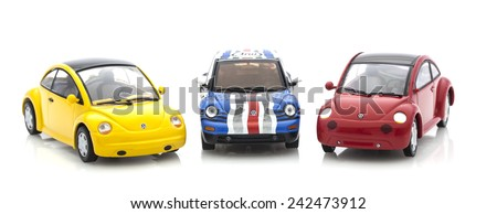 SWINDON, UK - DECEMBER 14, 2014:  3 VW Beetle  Die cast models on a white background. - stock photo