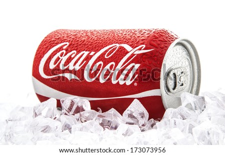 SWINDON, UK - JANUARY 25, 2014: Can of Coca-Cola on a bed of ice over a white background - stock photo