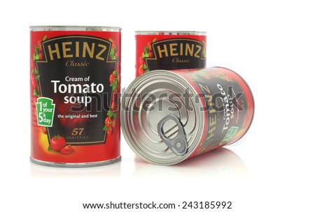 SWINDON, UK - JANUARY 11, 2015: Three  Heinz Tomato Soup Tins  shot in studio on white background  - stock photo
