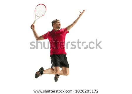 Swing and kick. Player throw in flight, attack, ball feed. Jump. Caucasian man playing tennis at studio. Player jumping, isolated on white background in full length with racquet. Emotions, face