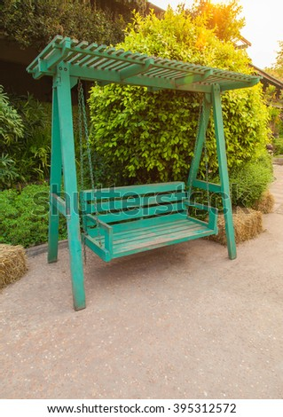 Swing bench in the garden, Selective Focus. - stock photo