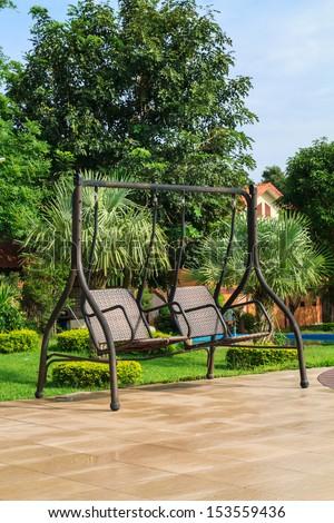 Swing in the garden - stock photo