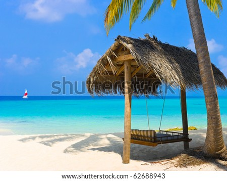 Swing on a tropical beach - vacation background - stock photo