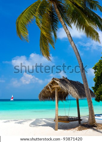 Swing on a tropical beach - vacation symbol - stock photo