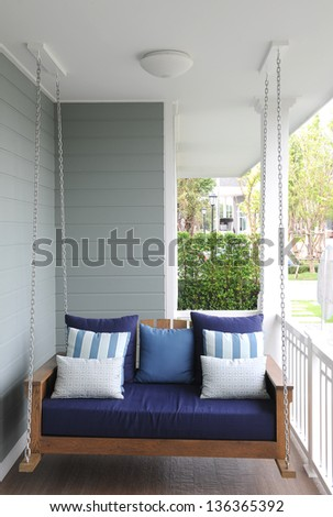 Swing seat with pillow - stock photo